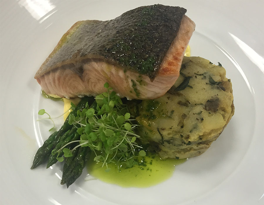 Atlantic Salmon, mint and caper crushed potatoes, charred buttered asparagus with lemon hollandaise